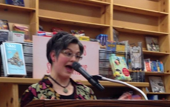 Me, having fun reading at Powell's. (Sorry it's a little blurry--it's an action shot!)
