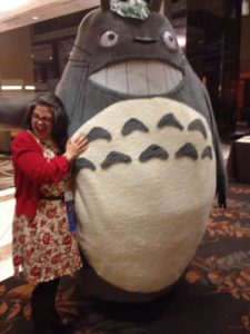 Unstaged reaction to hugging Totoro. Photo by Remy Nakamura.